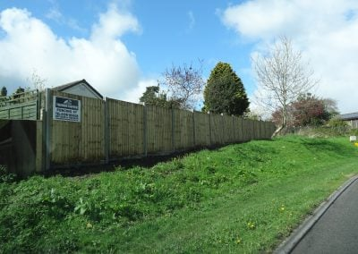 Slotted fencing with concrete posts