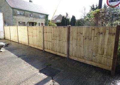 Garden close board fence with concrete posts