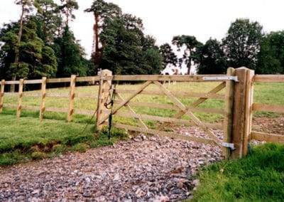 Field gate installed with post and rail