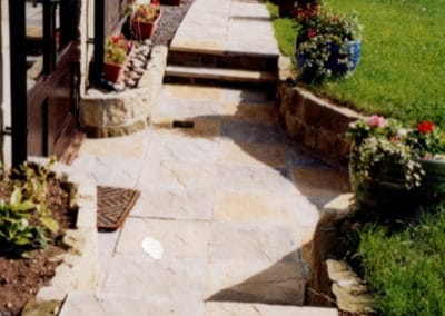 Slabbed walkway with small retaining stone walls