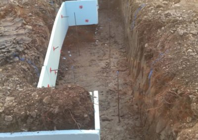 Footings excavated to building regs spec, clay boards installed