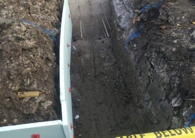 Footings excavated to building regs spec, clay boards installed, first stage of concreting done