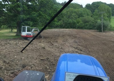 Field levelled and grass seeded.